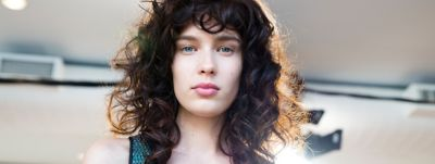 Woman with curly voluminous hairstyle