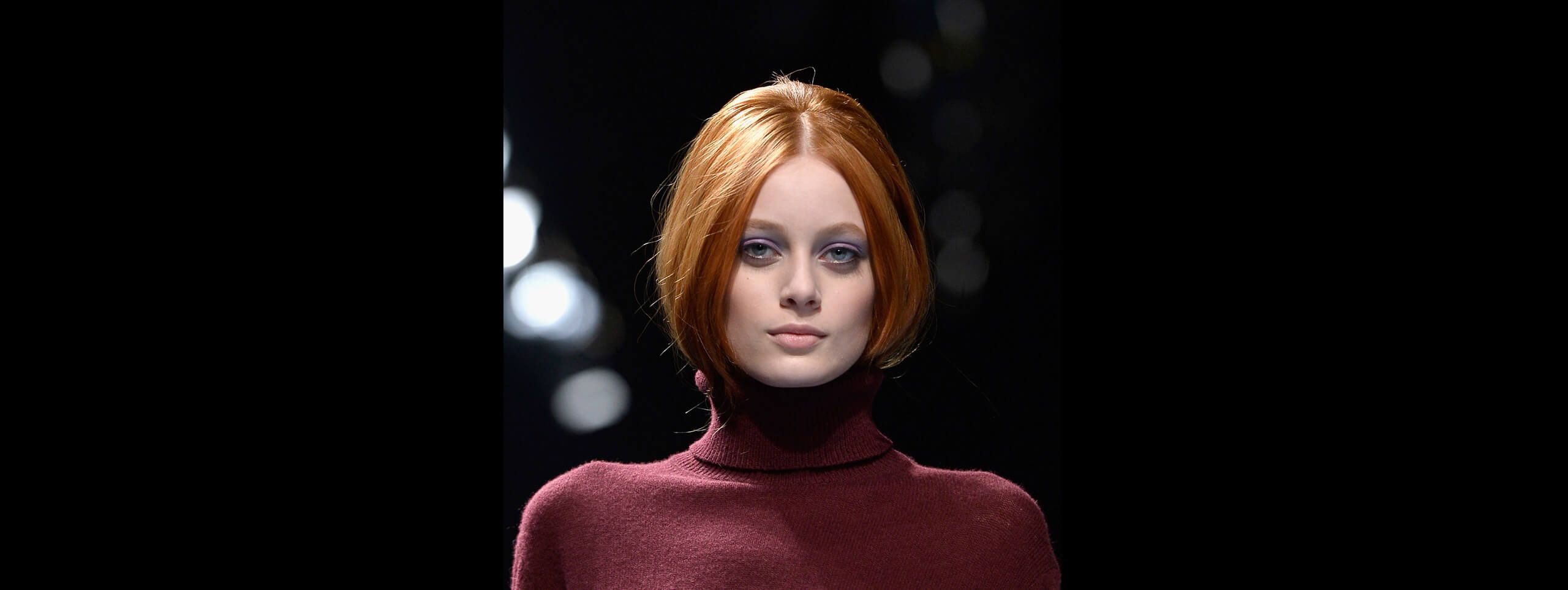 Woman with hairstyle tucked into turtleneck