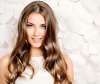 Woman with long lustrous wavy hairstyle