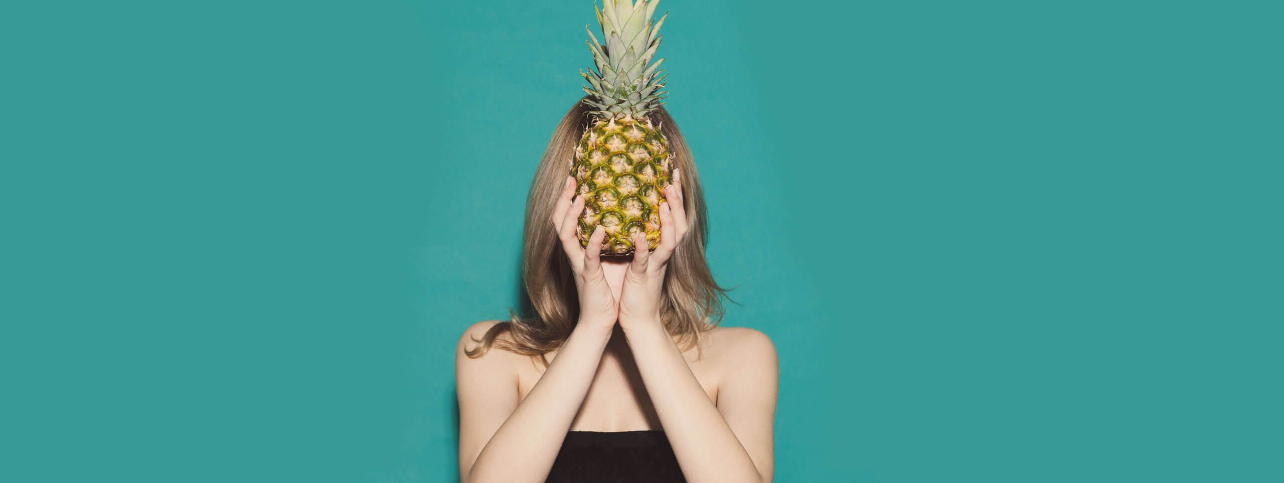 Woman with pineapple and soft tousled hairstyle