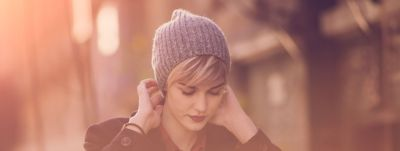woman-with-short-hairstyle-wearing-a-beanie-wcms-us