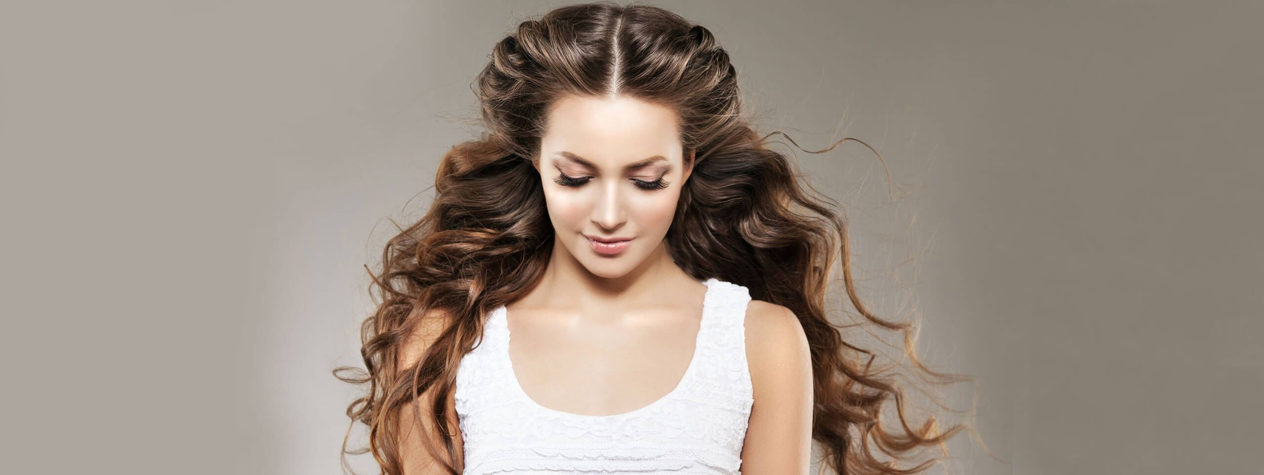 Woman with voluminous curly hairstyle