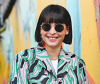 woman with pageboy haircut wearing sunglass